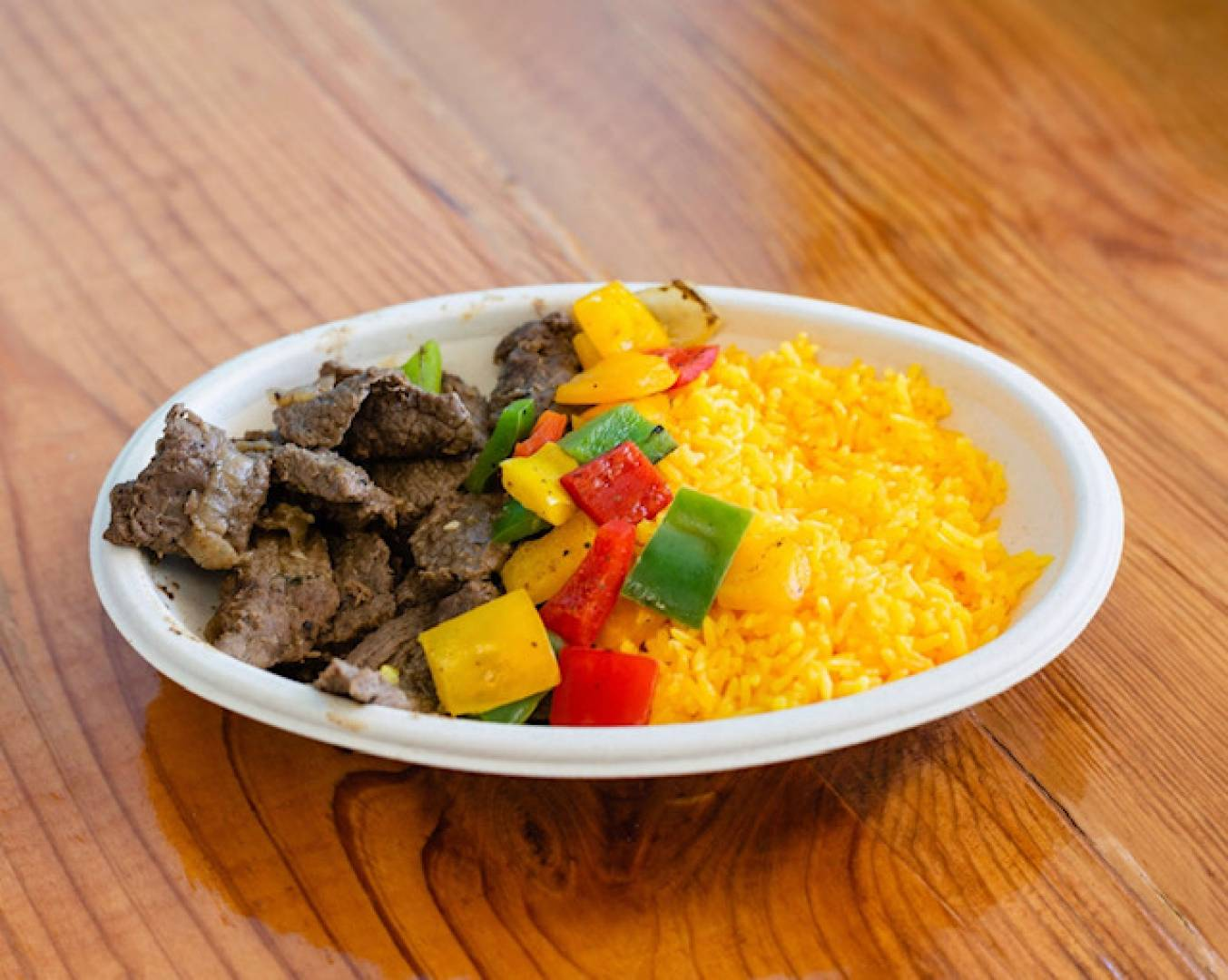 Steak, Yellow Rice and Tri Color Peppers
