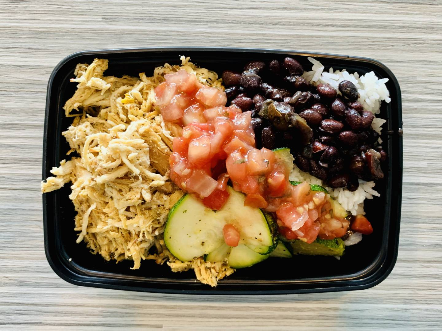 Shredded Chicken, Jasmine Rice, Black Beans, Pico de Gallo and Zucchini